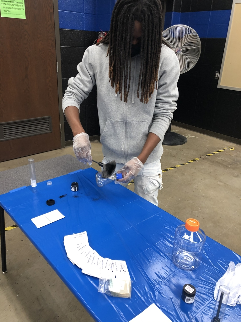 Student dusting for fingerprints