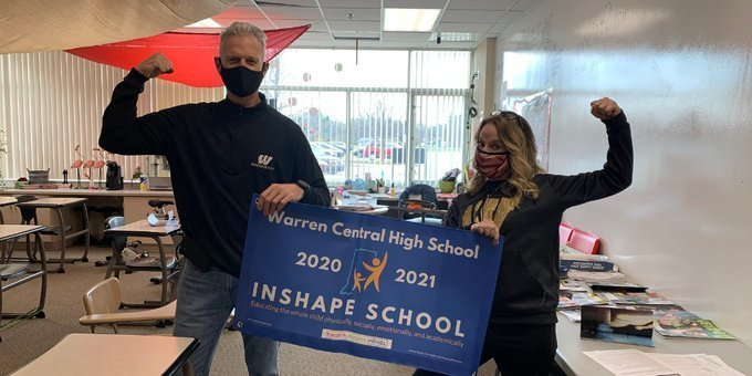 Principal Shepler and Ms. Handy receives INSHAPE School Award  honoring Warren Central High School