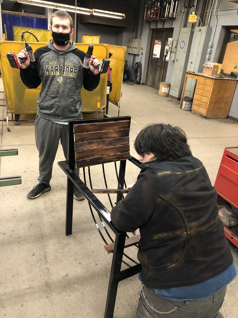 Students in welding building a chair.