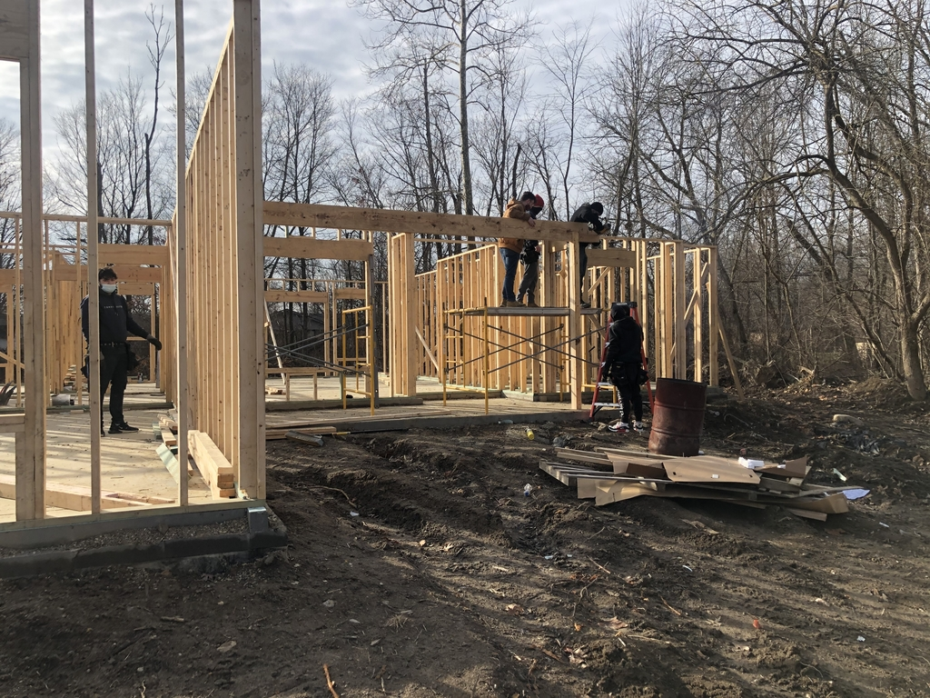 Students working on framing construction trades home.