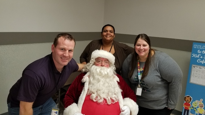 Hawthorne fourth grade team sitting around Santa