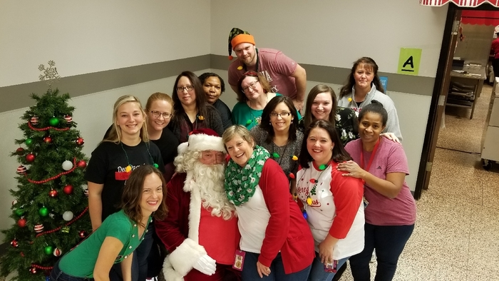 Hawthorne Staff sitting around Santa