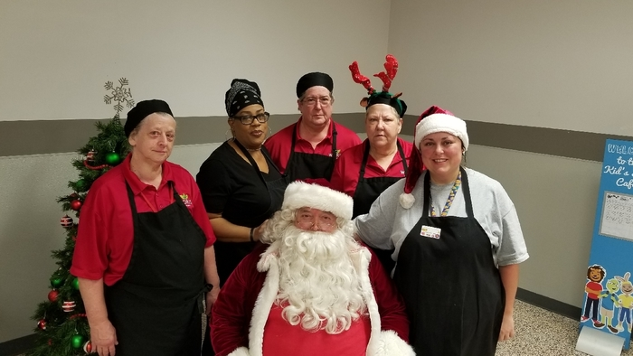 Hawthorne Chartwells staff sitting around Santa