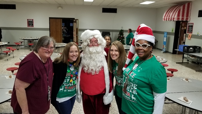 First grade team sitting around Santa.