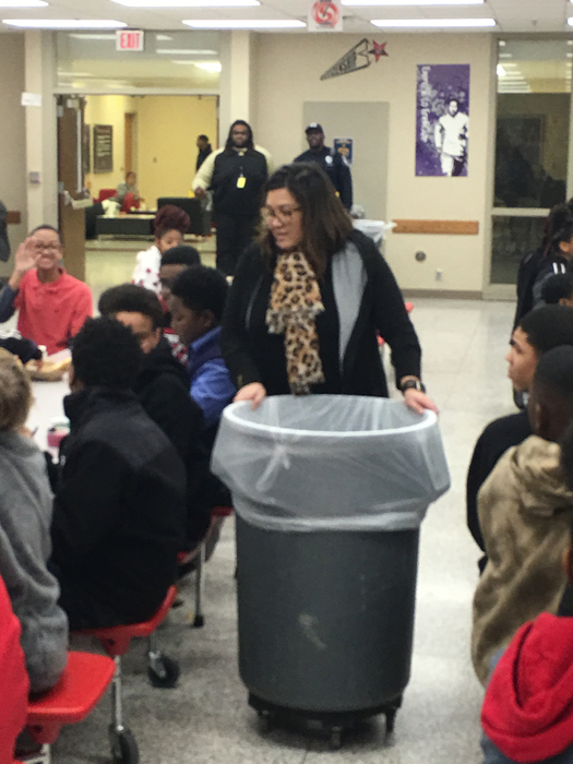 Administrator collecting trash during lunch.