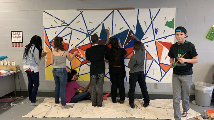 CMS art club working on the mural