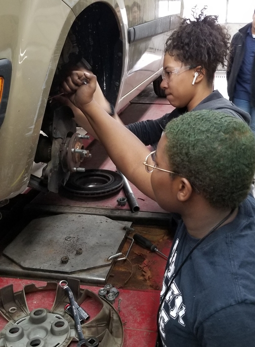Girls in Auto Service replace wheel bearings