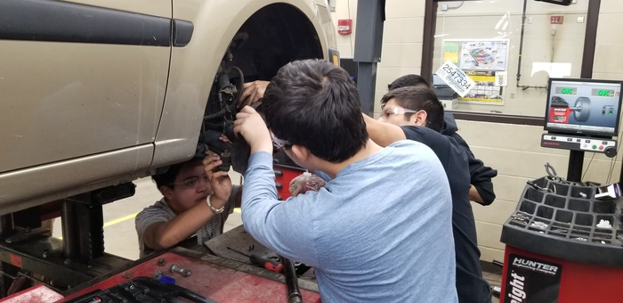 Students in Auto Service removing a steering knuckle