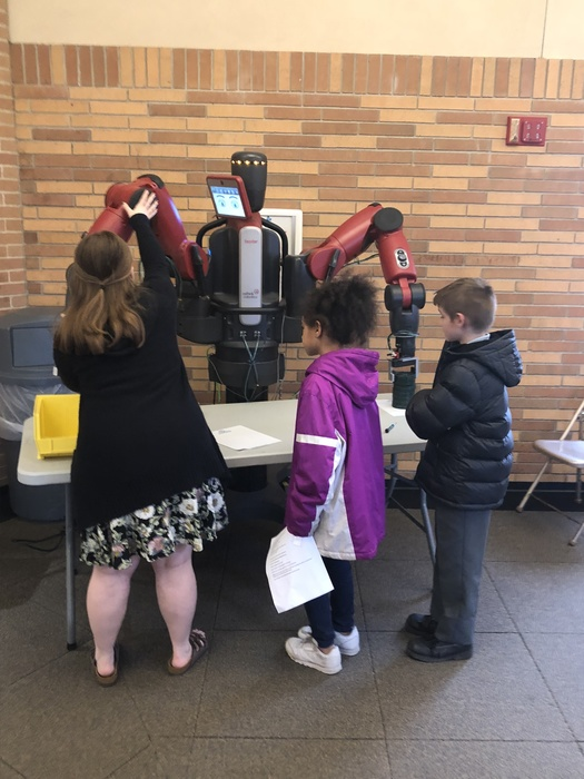 Students interact with robot at the 2018 STEAM Fair