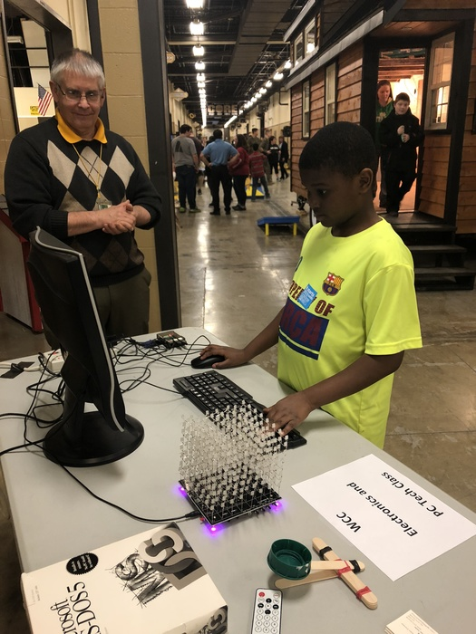 Student learns to program light cube at the 2018 STEAM Fair