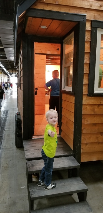 A child checks out the student-built Tiny House.