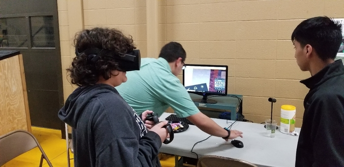 Student uses virtual reality to check out a student designed home.