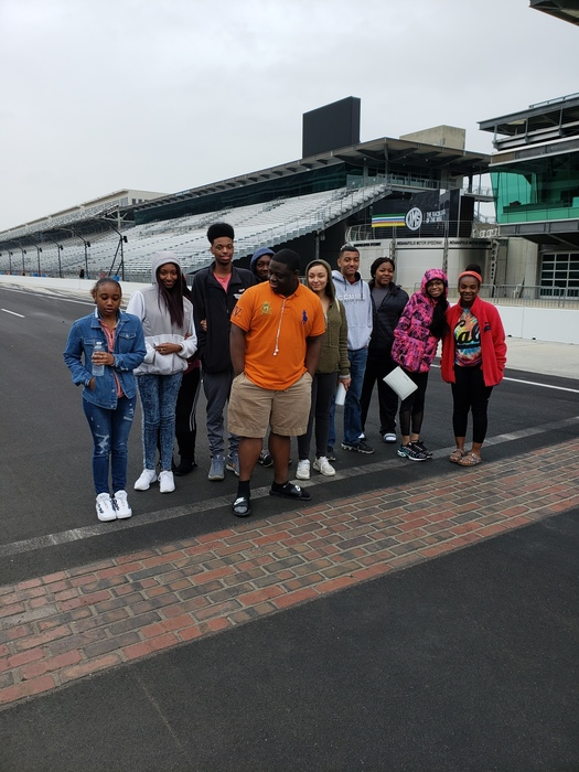 Walker Career Center students in front of the yard of bricks at Indianapolis Motor Speedway