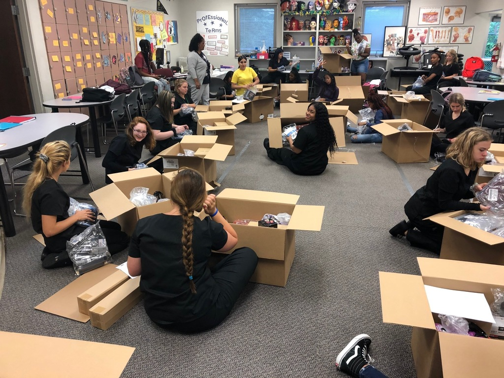 Cosmetology students open up their kits.
