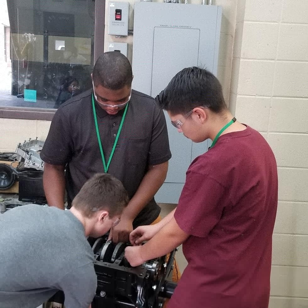 Students in Auto Service get hands on experience as they take engines apart.