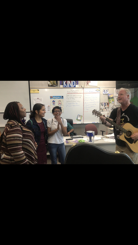 Reading and Spanish teacher Mr. Barrett sharing his guitar skills and the joy of music to his students!