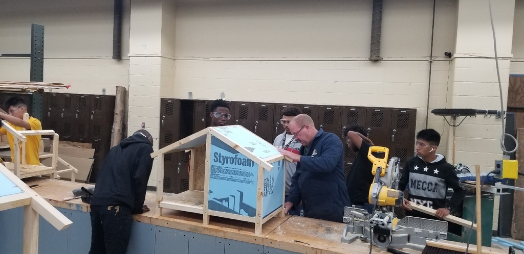 Students building dog houses in our Intro to Construction class.