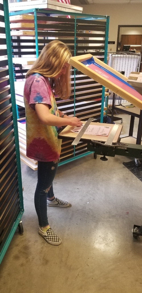 Student in Graphic Design working on screen printing.