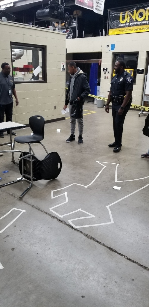 Student trying to solve a mystery by examining a crime scene.