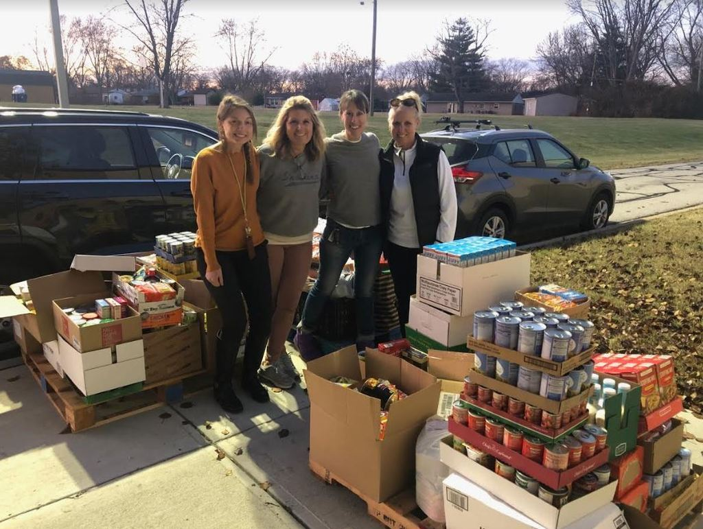 SC Sponsors Kaminski and Moir (middle) are assisted by Wenning (left) and Simmons (right) is delivering donated food to Sonny Day.