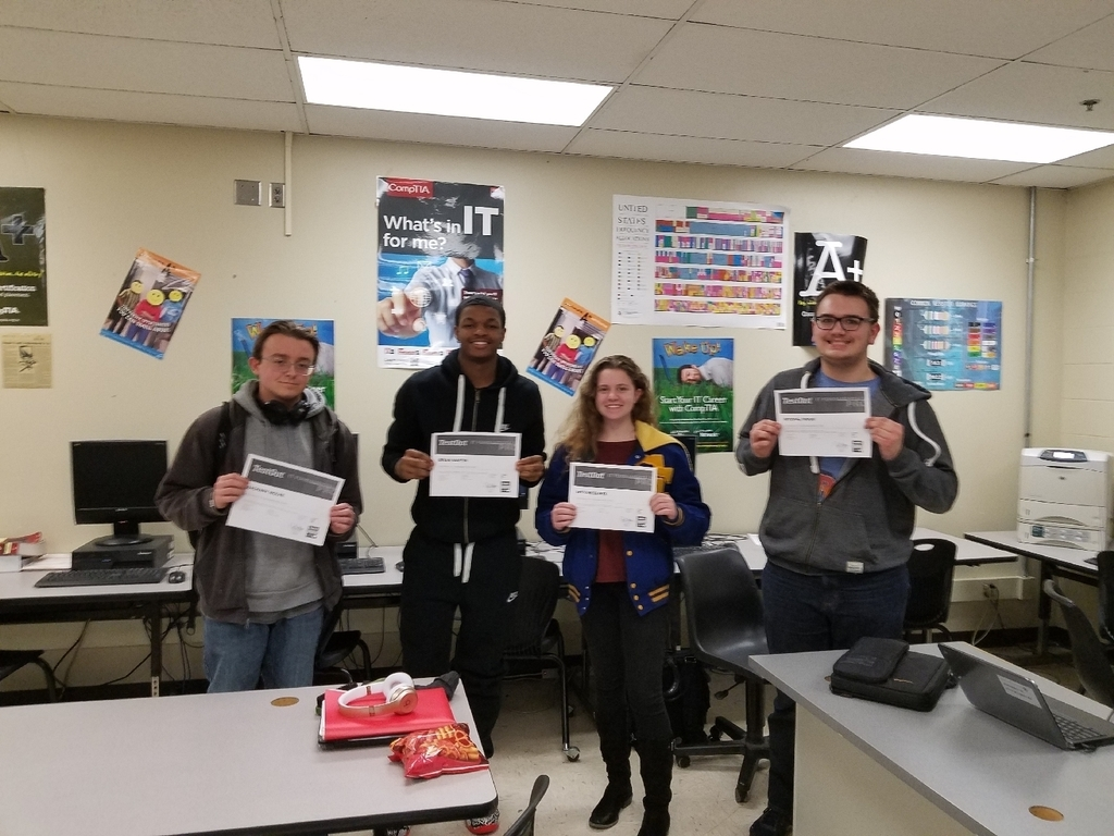 IT Support students showing off their new certifications.