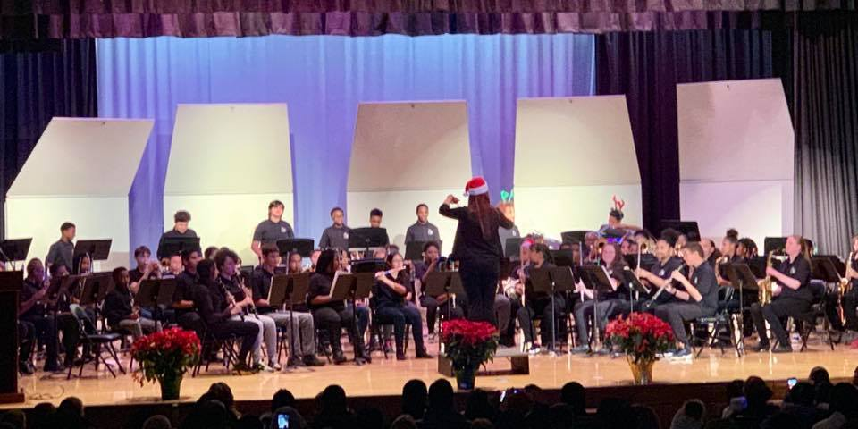 The CMS 7th Grade band performs at the holiday concert.